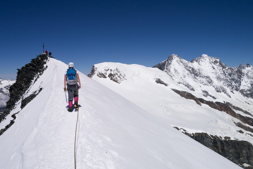 Walking up the snow arete to the summit