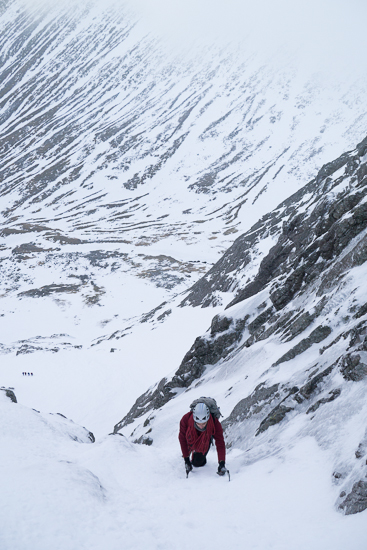 Soloing up the initial ice to the first belay ledge