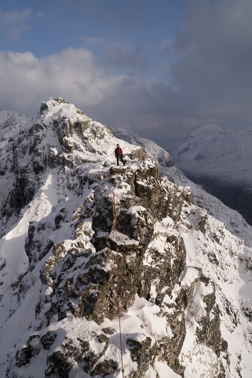 Ruth at the start of the crux of Aonach Eagach in the sun