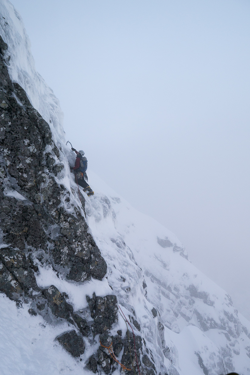 Nick leading the crux traverse of Orion Face Direct