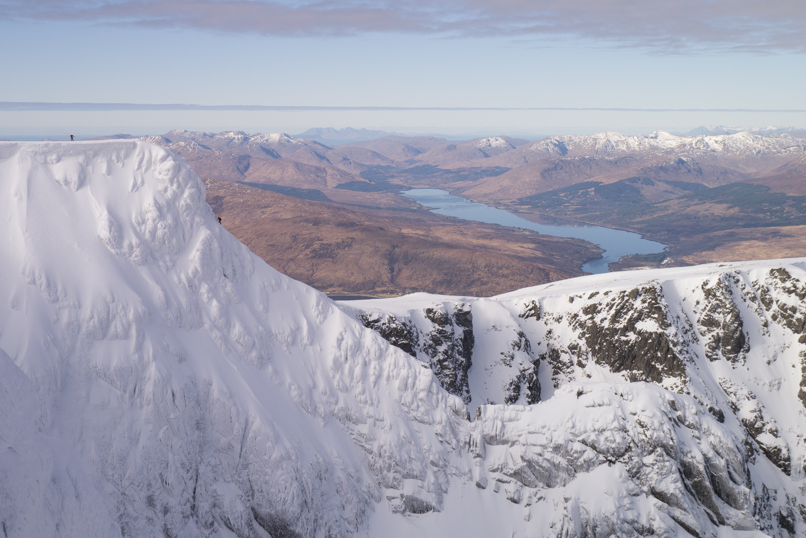 Climbers on Tower Ridge with the Cuillins in the background