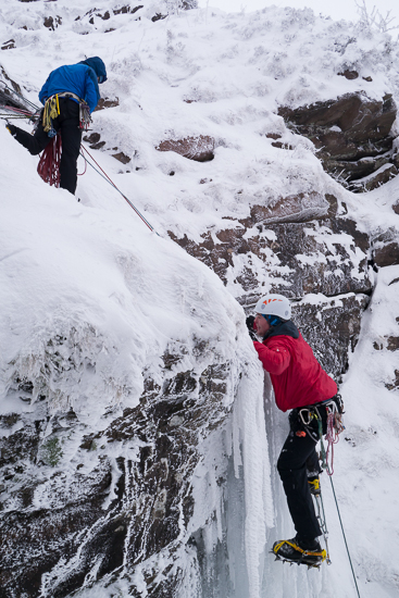 Zack climbing the ice pitch on Waterfall Gully
